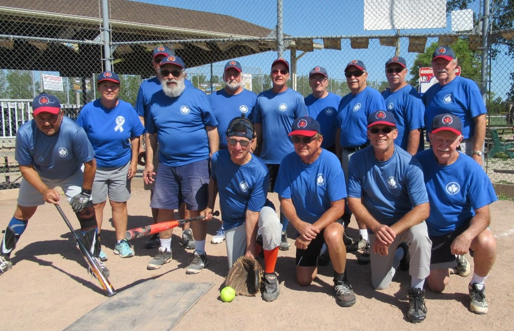 Team #12 Fossils: Front Row are 7 players (2 standing) - Mike Farah, Cisco Maden (scorekeeper) Allen Shearn, Tom(George) Goebel, Ron Breault, Norm Kennette and Don Trott Back Row: Rick Drummond, Peter Fiss, Terry Renaud, Phil Ochs, Tom Bois, Dave Strang and Brian Adlam